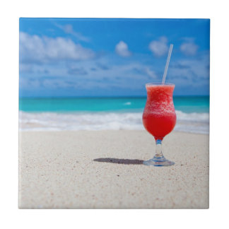 Red Strawberry Drink on the Sandy Beach Tile