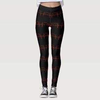 Red stylish heart beat pattern on black leggings