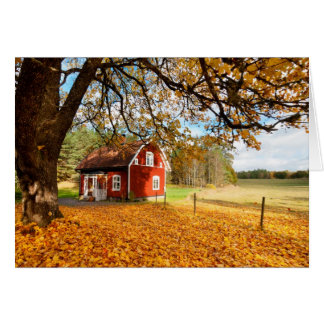 Red Swedish House Amongst Autumn Leaves Card