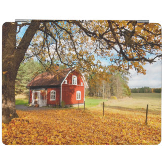 Red Swedish House Amongst Autumn Leaves iPad Cover