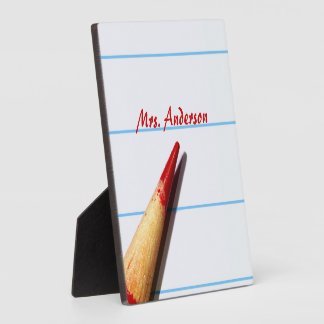 Red Teacher Pencil On Lined Paper With Name Plaque