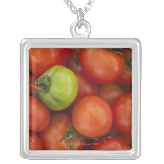 red tomatoes with one green one for sale at the silver plated necklace