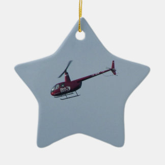 Red tourist helicopter. ceramic star decoration