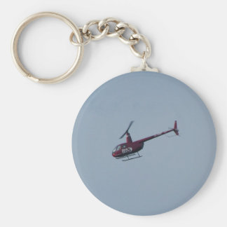 Red tourist helicopter. key ring