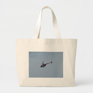 Red tourist helicopter. large tote bag
