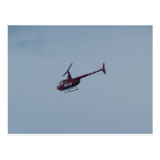 Red tourist helicopter. postcard