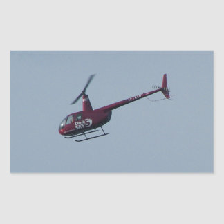 Red tourist helicopter. rectangular sticker