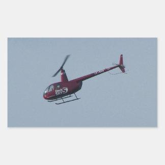 Red tourist helicopter. rectangular sticker
