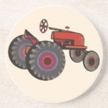 Red tractor on a sandstone coaster