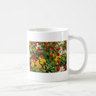 Red Tulips, pansies, daisies and primulas flowers Mug