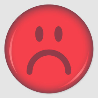 Red unhappy pouty angry smiley face round sticker