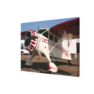 Red & white high wing aircraft canvas print