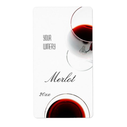 Red wine in a glass wine label