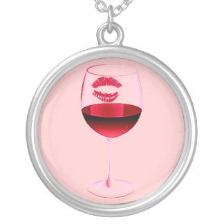 RED WINE IN PINK GLASS WITH LIPSTICK PENDANTS