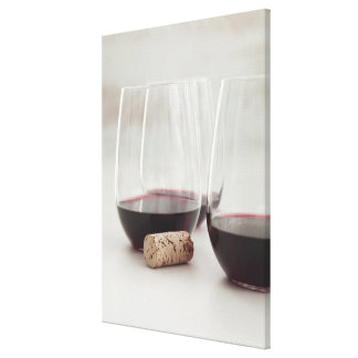 Red wine in stemless glasses canvas print