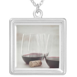 Red wine in stemless glasses silver plated necklace