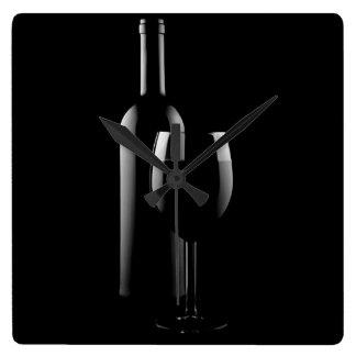 red wine on black wall clock