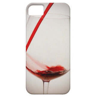 Red wine pouring into glass, close-up iPhone 5 cover