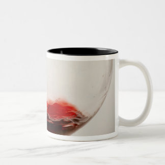 Red wine pouring into glass, close-up Two-Tone mug
