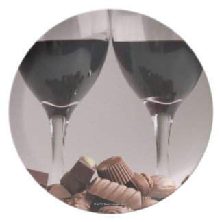 red wine with chocolates plate