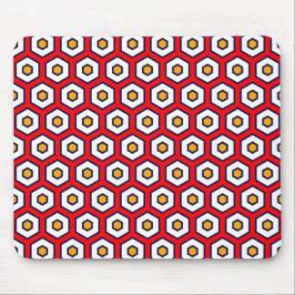 Red with yellow, blue and white honeycomb hexagons mouse pad