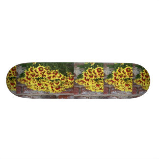 Red Yellow Flowers against brown red brick wall 19.7 Cm Skateboard Deck