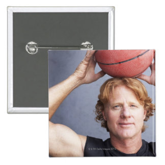 Redhead holding a basket ball over his head 15 cm square badge