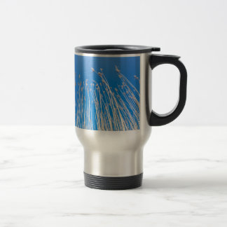 Reed stems with plumes against blue sky in spring stainless steel travel mug