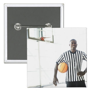 Referee holding basketball on court 15 cm square badge