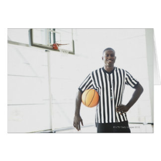Referee holding basketball on court card