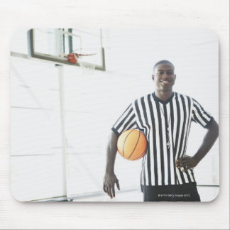 Referee holding basketball on court mouse pads