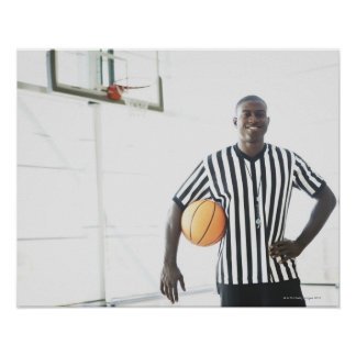 Referee holding basketball on court poster