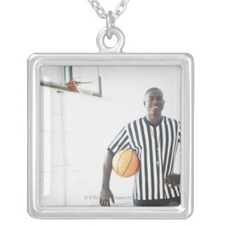 Referee holding basketball on court silver plated necklace