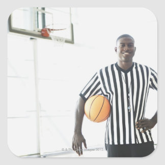 Referee holding basketball on court square sticker