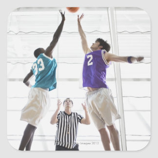 Referee watching basketball players jumping square sticker