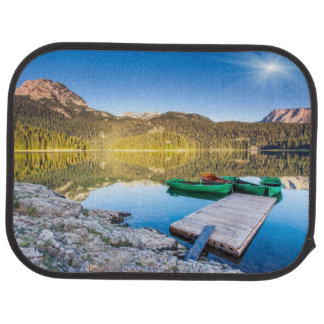 Reflection in water of mountain lakes and boats car mat