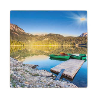 Reflection in water of mountain lakes and boats wood coaster