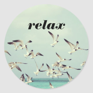 Relax with Seagulls Flying Over Beach Classic Round Sticker