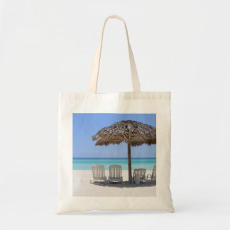 Relaxing at the beach tote bag