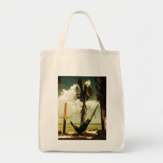 Relaxing tropical hammock nap grocery tote bag