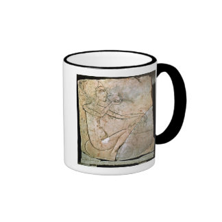 Relief depicing a princess eating a roasted mugs