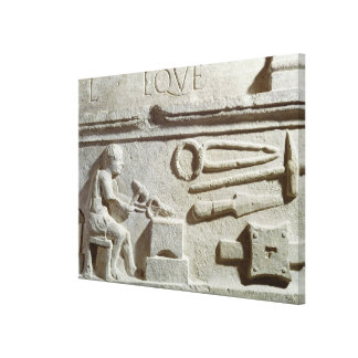 Relief depicting a blacksmith's shop and tools canvas print