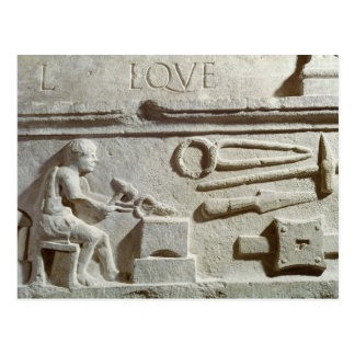 Relief depicting a blacksmith's shop and tools postcard