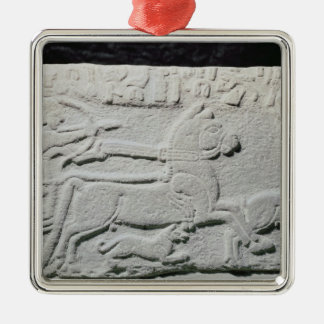 Relief depicting a deer hunt christmas ornament