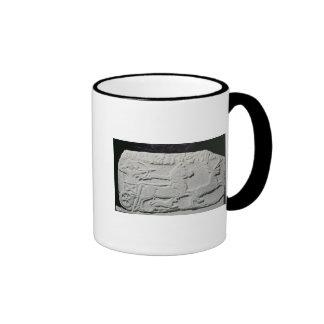 Relief depicting a deer hunt ringer mug