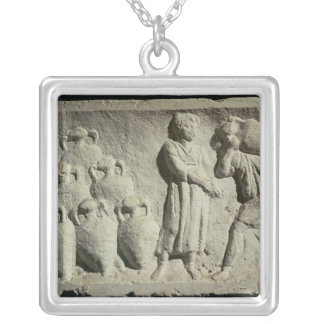 Relief depicting a delivery of wine silver plated necklace