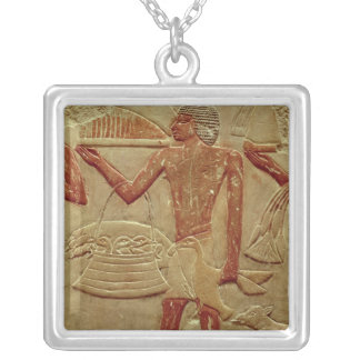 Relief depicting a porter silver plated necklace