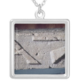 Relief depicting a stonemason's instrument silver plated necklace
