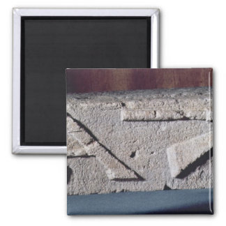 Relief depicting a stonemason's instrument square magnet