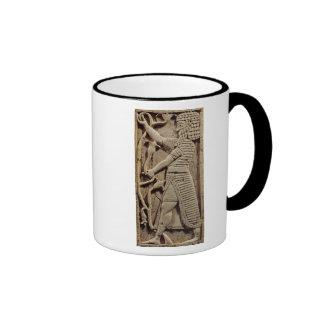 Relief depicting a warrior coffee mug